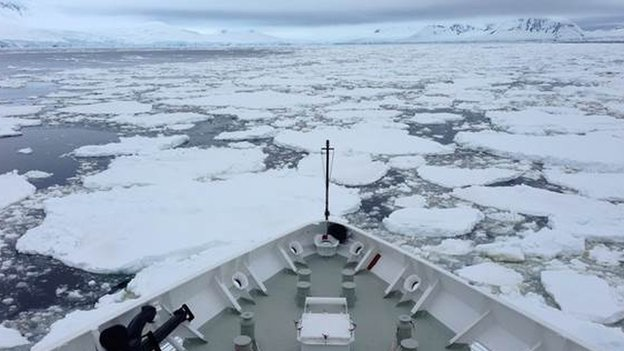 An icebreaker nudges its way towards Antarctica