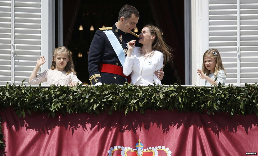 Spain's new King Felipe VI, his wife Queen Letizia, Princess Sofia and Princess Leonor (left) appear on the balcony of the Royal Palace in Madrid, on 19 June 2014