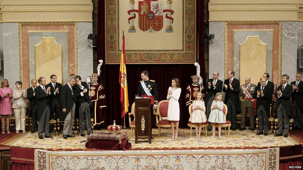 Spain's new King Felipe VI is applauded as he stands next to his wife Queen Letizia, and their daughters Princess Leonor and Princess Sofia during the swearing-in ceremony at the Congress of Deputies in Madrid, on 19 June 2014