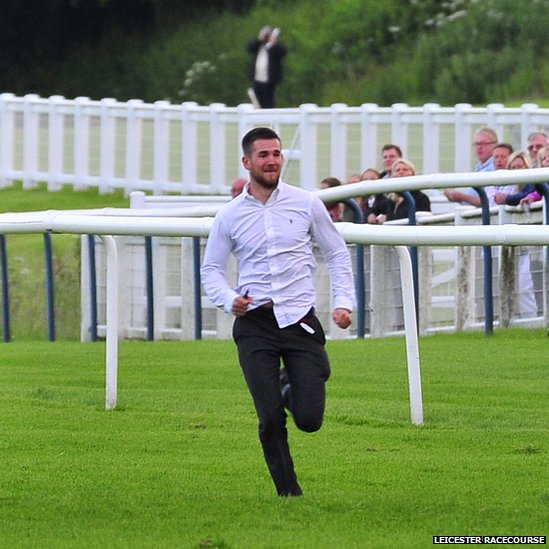 The man runs along the track