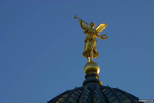 Pheme (Fama) at the top of the cupola of Dresden's Akademie