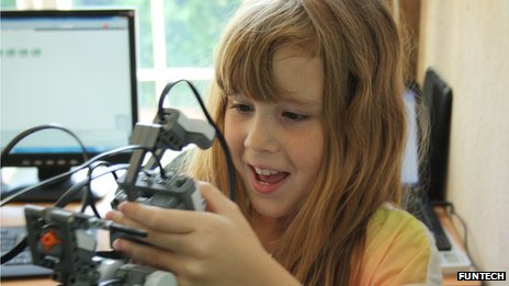 young girl learning robotics