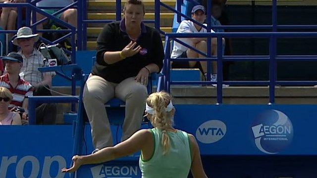 Caroline Wozniacki receives an apology from umpire Alison Hughes