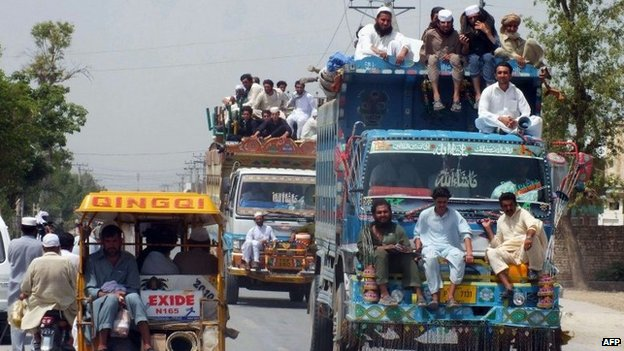 Pakistani civilians, fleeing from a military operation in North Waziristan tribal agency, arrive in Bannu district on June 18, 2014