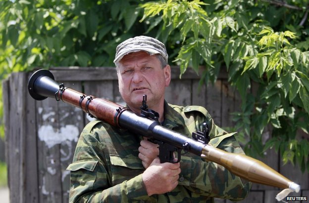 A rebel fighter holds a grenade launcher in Siversk, near Krasnyy Liman, 19 June