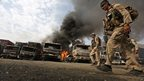 Afghan policemen investigate the scene of a suicide attack in Torkham, Nangarhar province, Afghanistan. 19 June 2014