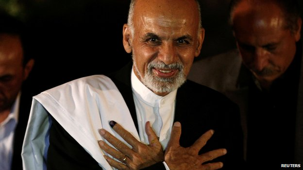 Afghan presidential candidate Ashraf Ghani Ahmadzai attends a news conference in Kabul on 14 June 2014.