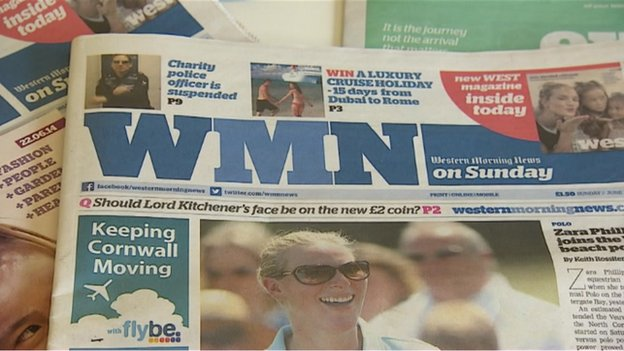 A dummy edition of Sunday's newspaper