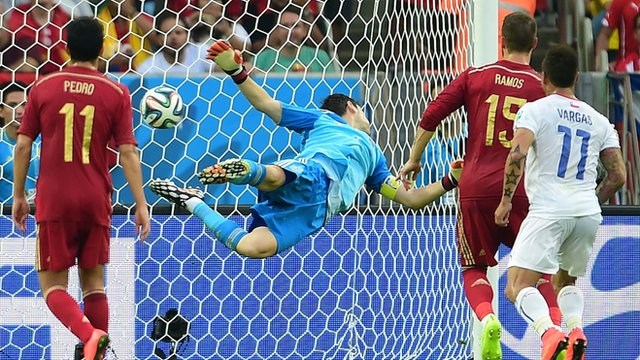 Chile's Eduardo Vargas scores against Spain's Iker Casillas