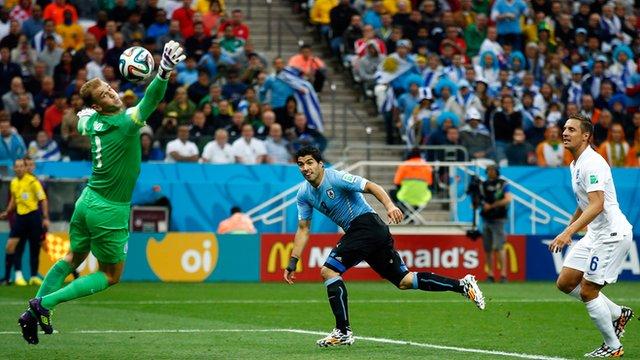 Uruguay's Luis Suarez scores against England