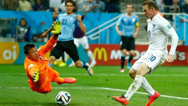 England's Wayne Rooney scores against Uruguay