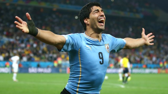 Uruguay's Luis Suarez celebrates after scoring his second goal against England