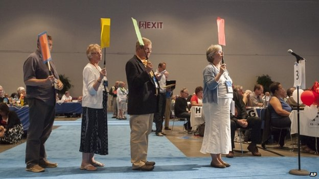 Commissioners and advisors wait in line to debate a vote on whether the church should recognize same-sex marriage at the 221st General Assembly of the Presbyterian Church at Cobo Hall, in Detroit, 19 June 2014