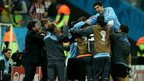 Goal hero Suarez celebrates the 2-1 win with staff and team-mates