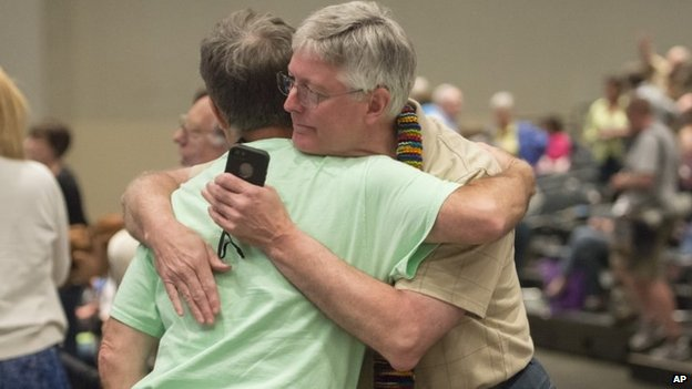 Gary Lyon, of Leechburg, PA, left, and Bill Samford, of Hawley, PA., celebrate after a vote allowing Presbyterian pastors discretion in marrying same-sex couples at the 221st General Assembly of the Presbyterian Church at Cobo Hall, in Detroit, Thursday, 109 June 2014
