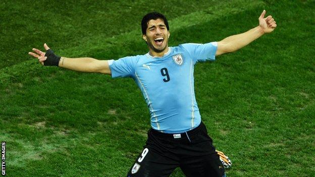 Suarez celebrates his winning goal.