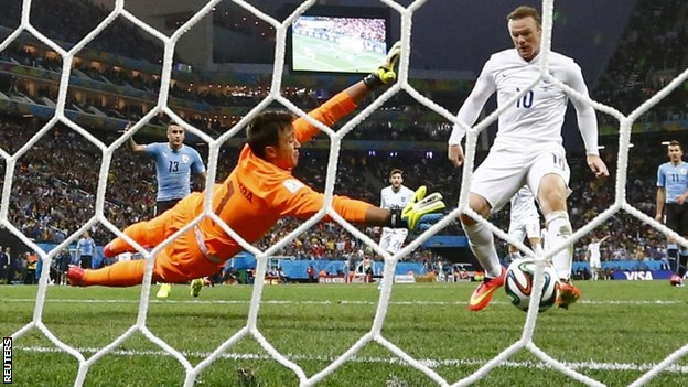 Wayne Rooney scores for England against Uruguay