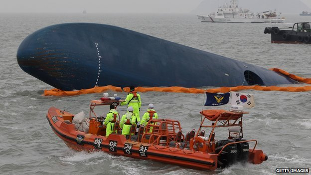 South Korean Coast Guard and rescue teams search for missing passengers at the site of the sunken ferry off the coast of Jindo Island on 17 April, 2014 in Jindo-gun, South Korea