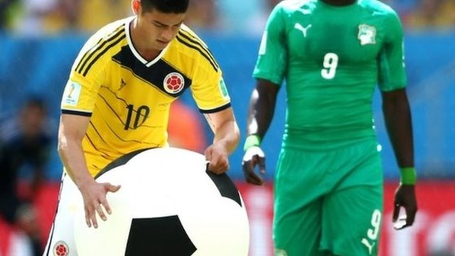 Colombia's James Rodriguez tackles an inflatable