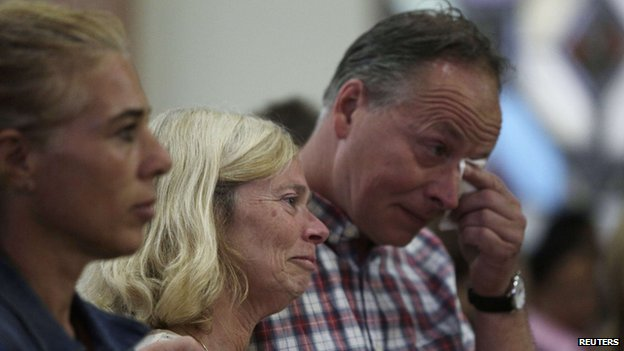 Hans Kremers (R) and his wife Roselie, parents of Kris Kremers, attend a service held for their missing daughter and her friend on Holy Thursday at a local church in Boquete town April 17