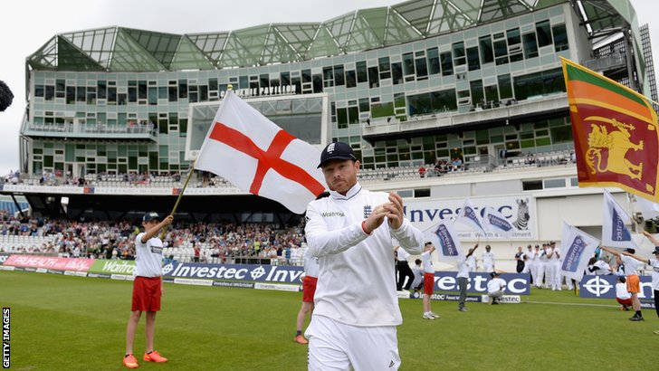 England's Ian Bell leads the side out
