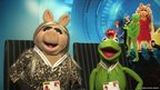 Miss Piggy and Kermit wearing School Report press passes