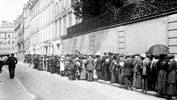 Tourists queue outside the British Consulate for permits to leave Paris.