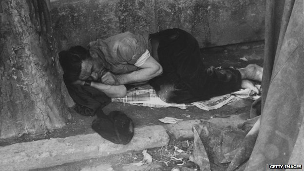 Sleeping man on street of Paris