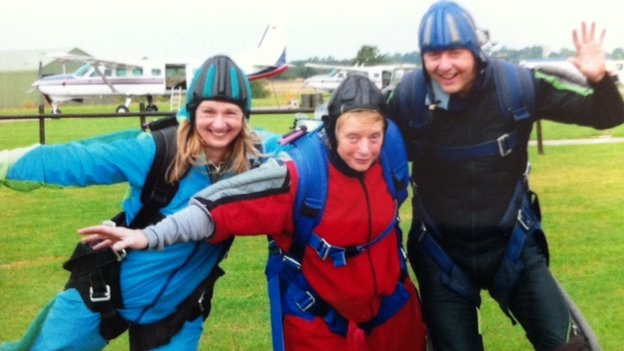 Barbara Watson (centre) with son and daughter after parachute jump