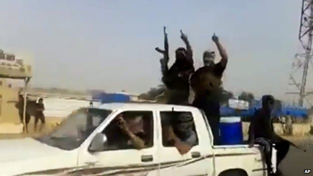 An image taken from jihadist video apparently shows ISIS militants arriving at the oil refinery in Baiji, north of Baghdad, Iraq, on 17 June 2014