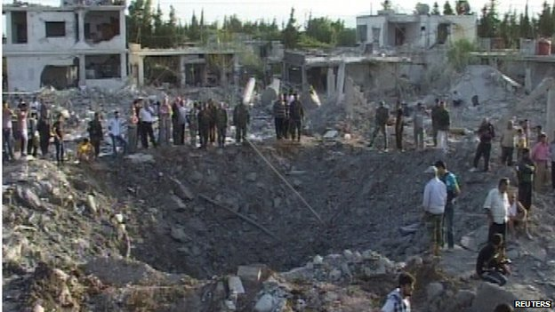 Scene of car bombing in Hama (20/06/14) - picture from Syria's national news agency Sana