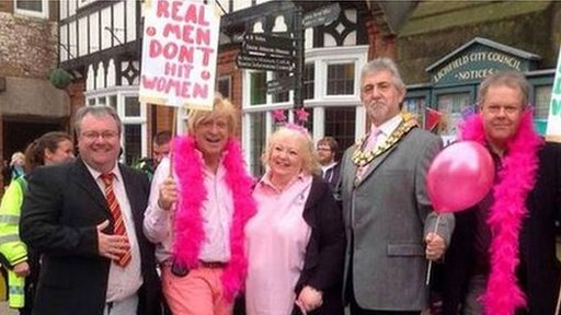 Mr Fabricant tweeted a picture of himself demonstrating against domestic violence in Lichfield last year