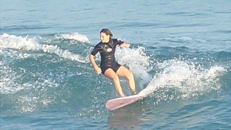 Roberta Milazzo surfing