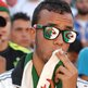 An Algerian fan watches a football match in  Algiers on 17 June 2014