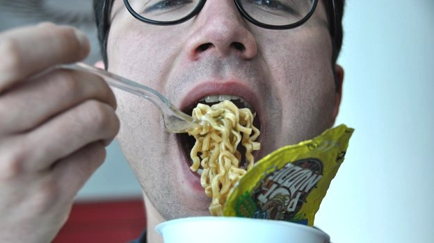 Man eating 'Brazilian' pot noodle