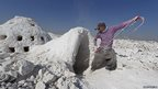An Iraqi labourer works at a cement factory in Bartala, to the east of Mosul