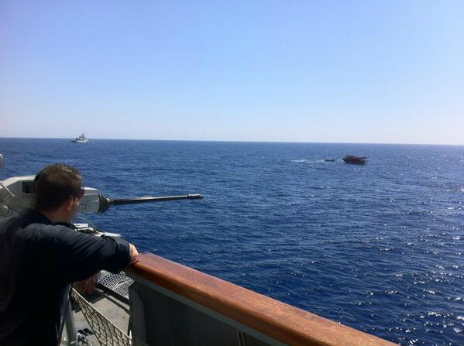 The view from the Italian navy vessel as it moved closer to the migrant boat - 20 June 2014