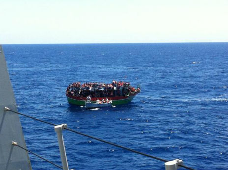 Migrants crammed on to a small boat on the Mediterranean - 20 June 2014