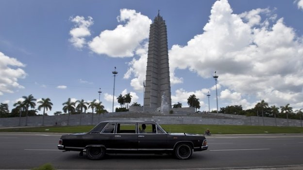 Driver Moises Suarez drives past Revolution Plaza in Havana. 18/06/2014