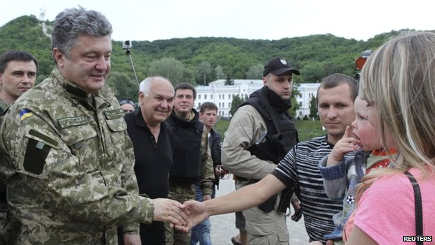 Ukraine's President Petro Poroshenko greets local residents in a town in eastern Ukraine - 20 June 2014