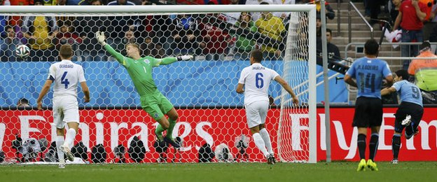 Uruguay striker Luis Suarez (right) scores the winner against England