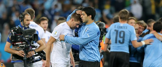 Uruguay striker Luis Suarez consoles England captain and Liverpool team-mate Steven Gerrard