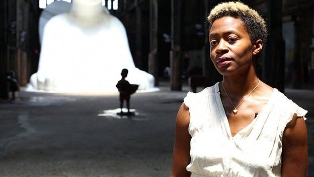 Kara Walker in front of her sugar sculpture