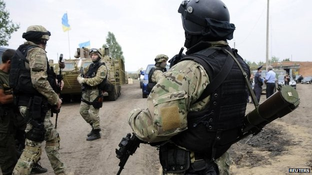 Ukrainian servicemen stand at a military camp near the town of Svyatogorsk in Eastern Ukraine, 20 June 2014