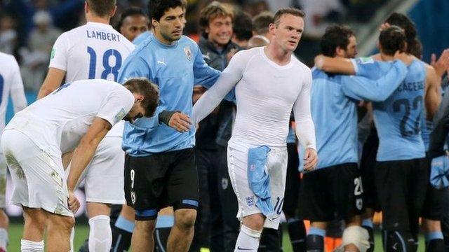 Luis Suarez consoles Wayne Rooney