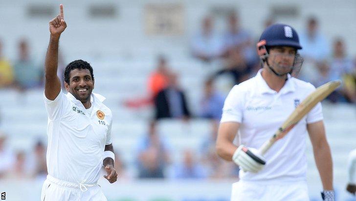 Sri Lanka's Dhammika Prasad celebrates the wicket of England captain Alastair Cook