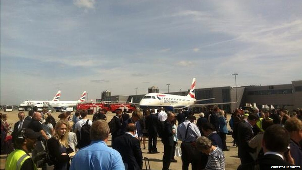 People standing on the tarmac at London City Airport.