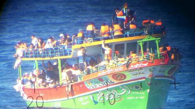 The loaded boat in the Mediterranean, showing migrants on board wearing lifejackets - 20 June 2014
