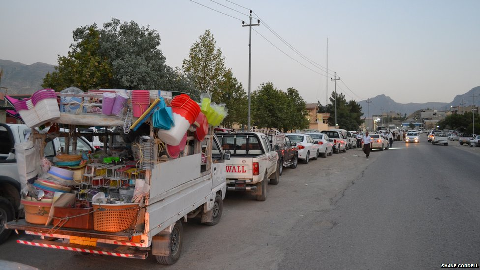 Vehicles queue for petrol in the city of Soran, Iraqi-Kurdistan.