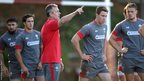 Wales backs coach Rob Howley gives the squad instructions during Tuesday's training session in South Africa.